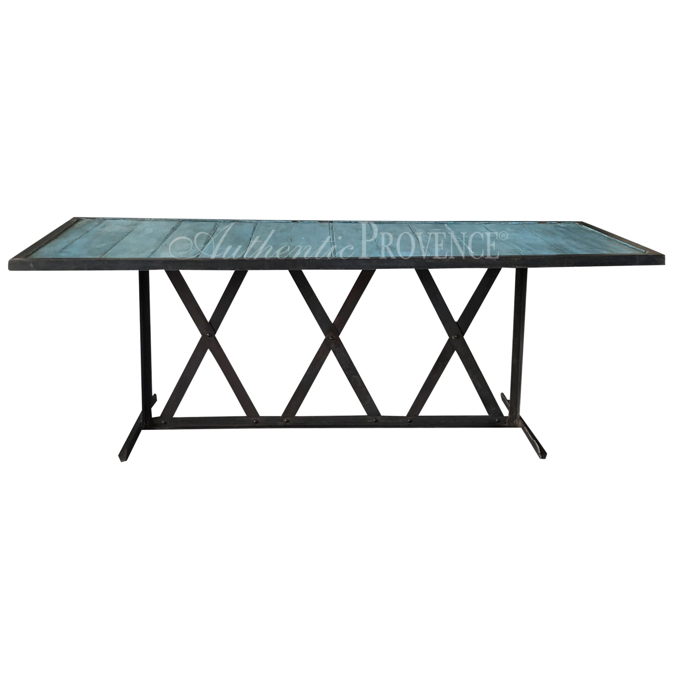 A rectangular dining table with turquoise painted wooden inlaid slats and iron base