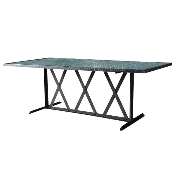 A rectangular dining table painted turquoise with an iron base