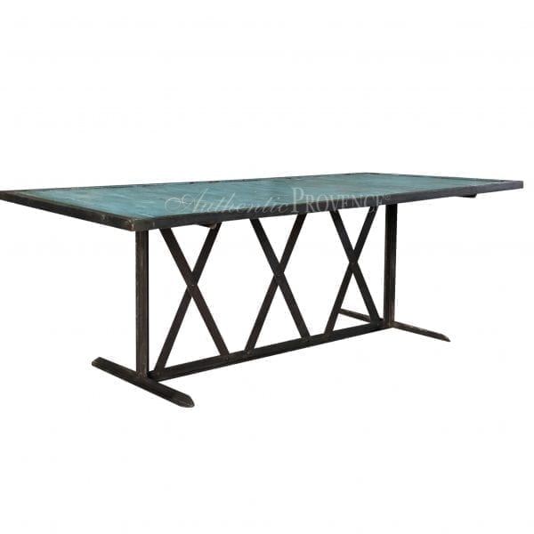 Side view of a rectangular dining table painted turquoise with an iron base