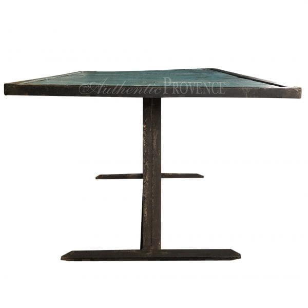 A rectangular wooden dining table painted turquoise with an iron base