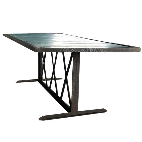Side view of a French rectangular dining table painted turquoise with an iron base