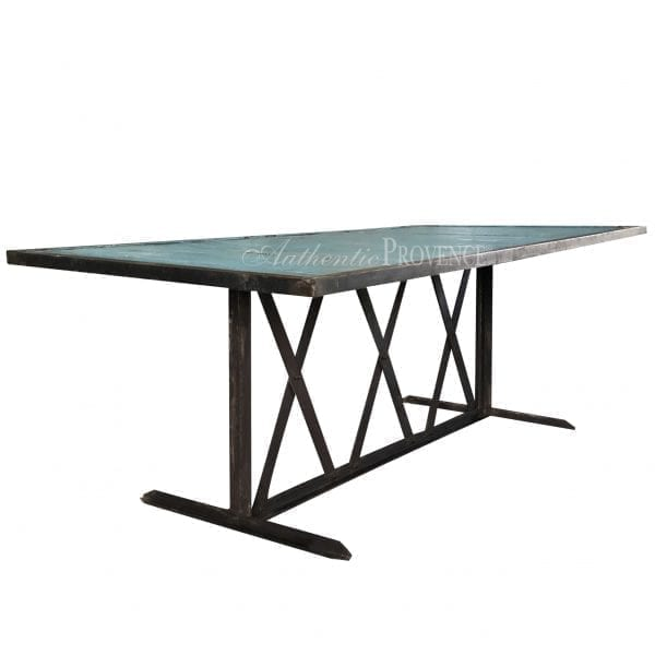 Side view of a French rectangular dining table with wooden inlay slats painted turquoise and an iron base