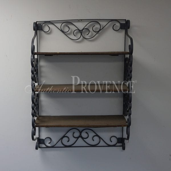 Wall etagere with three wooden shelves and wrought iron structure.