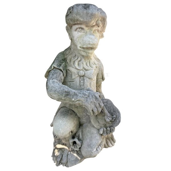 Limestone monkey statue carrying a painters palette dressed with typical basque hat.