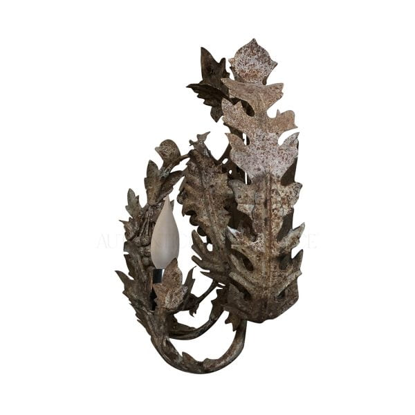 Side view of an iron wall sconce with delicate grapes and leaves cascading around the sconce