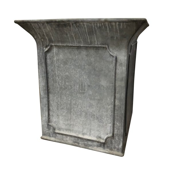 A large paneled border planter in galvanized metal with beveled panels and tulip shaped border rim