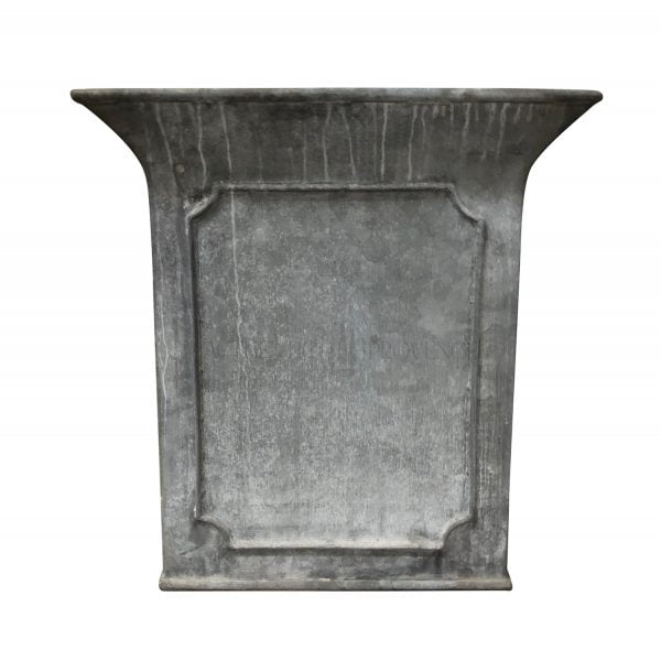 A large paneled border garden planter in galvanized metal with beveled panels and tulip shaped border rim