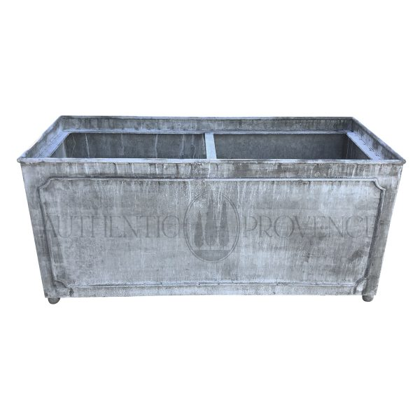 A large rectangular garden planter in galvanized metal with a lead finish