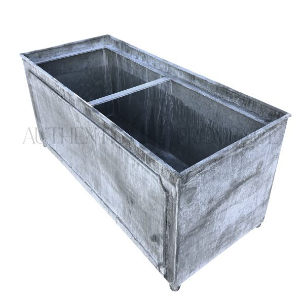 Side view of a large rectangular garden planter in galvanized metal with a lead finish