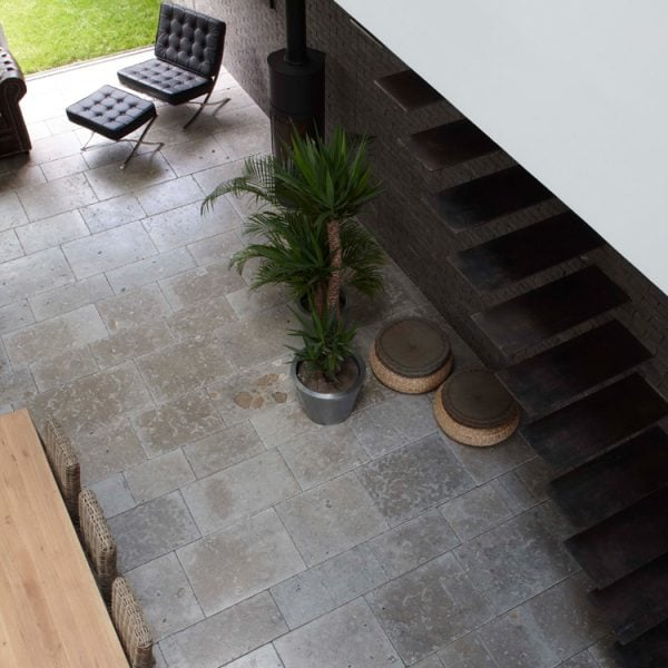 Overhead view of a refined blue grey to taupe dense colored limestone floor with a smooth surface and fine grain