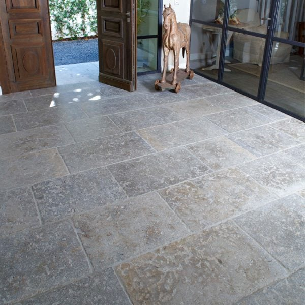 Refined blue grey to taupe dense colored limestone floor with a smooth surface and fine grain