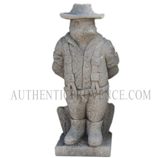 "One of set of four limestone ""moquerie"" statues representing different trades. This statue is of a duck farmer"