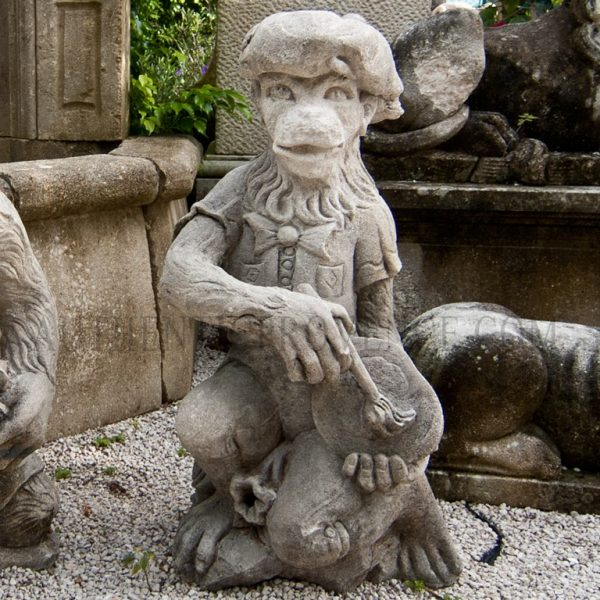 Decorative statue of a monkey carrying a painters palette dressed with typical basque hat.