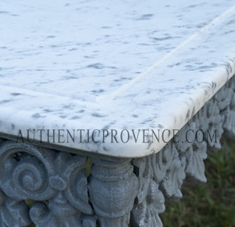 Close up of the corner of a marble top butcher table