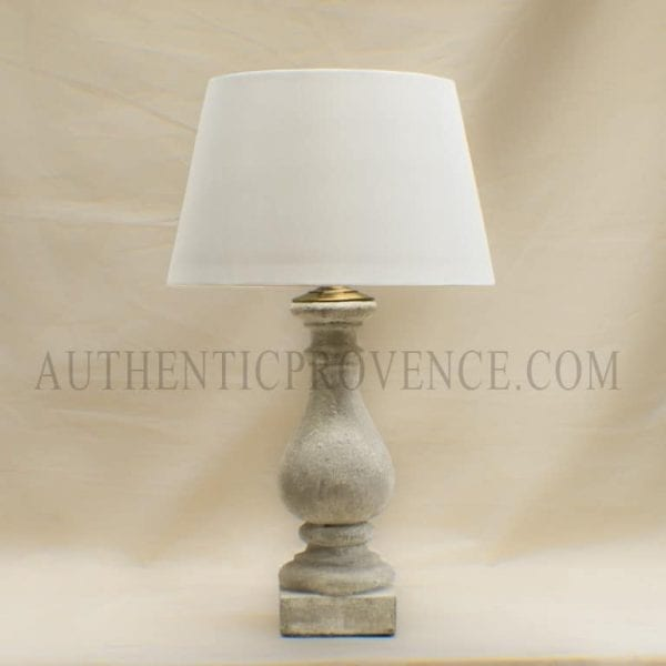 Traditional French baluster lamps with round fabric shades.