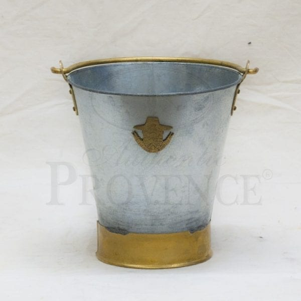 Tapered galvanized metal bucket or wine cooler with large brass ring on the bottom, handle and logo of Le Prince Jardinier