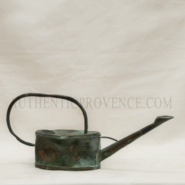 Rustic copper antique water can with a large fine handle and natural antique patina.