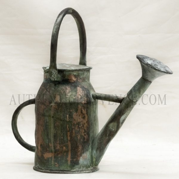 A large antique copper watering can with a natural antique patina from France with a side and top handle