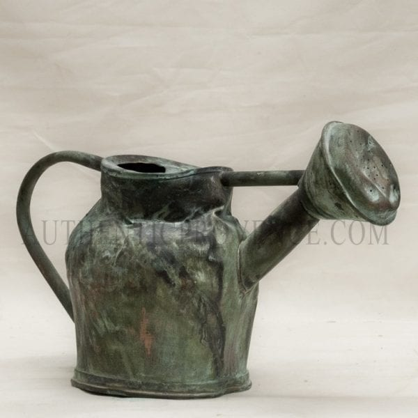 Fine watering can with an aged vert de gris patina