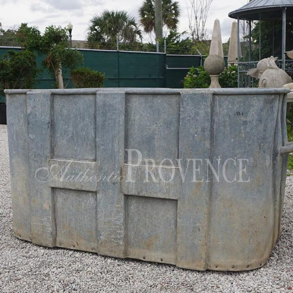 An old 20th Century rectangular metal water reservoir from France.