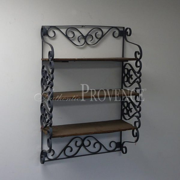 Side view of a wall etagere with three wooden shelves and wrought iron structure.
