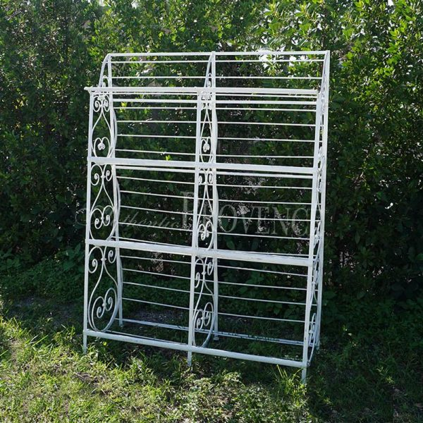 A 19th century Parisian baker's rack in iron with white wash. The sides are decorated with the typical scroll décor