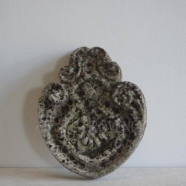 18th century limestone crest with central flower detail