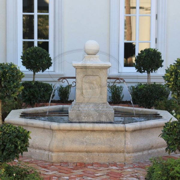 Octagonal garden fountain adorned by panels and small sphere on the short and wide column.