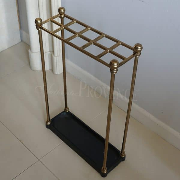 Side view of an umbrella stand made of cast iron and brass