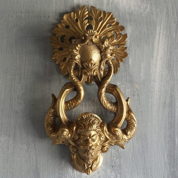 Door knocker depicting Neptune and dolphins in a Renaissance style with a round back plate and a ring