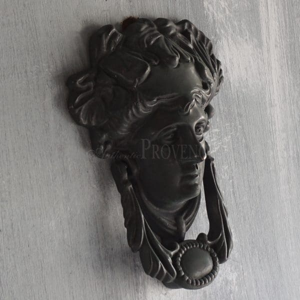 Side view of a beautifully detailed door knocker featuring Medusa.