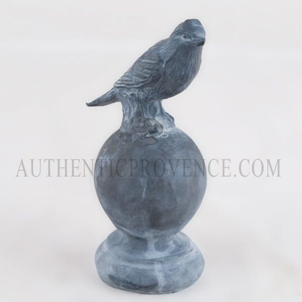 Figurine of a finch perched on a sphere from England