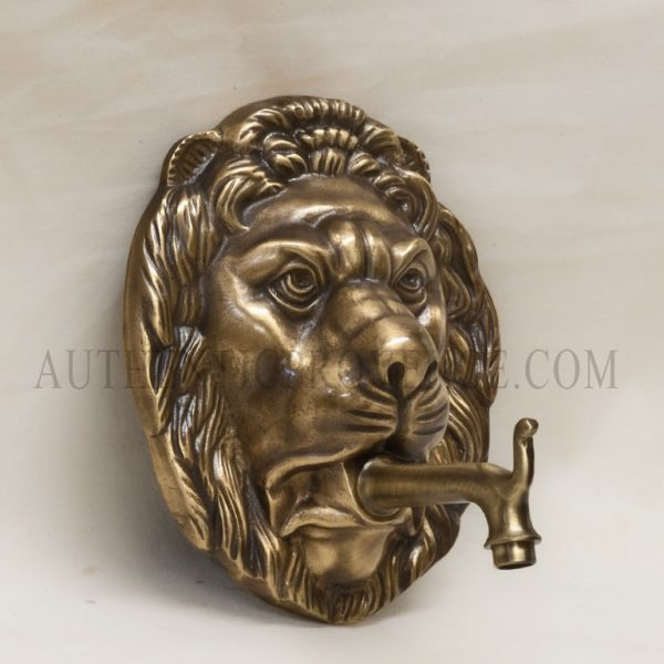 Large lion wall mount fountain maskwith simple spout.