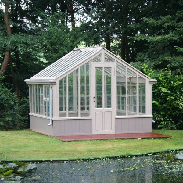 Antique architectural garden conservatory in reclaimed wood, antique glass and recently added hardware and gutters.