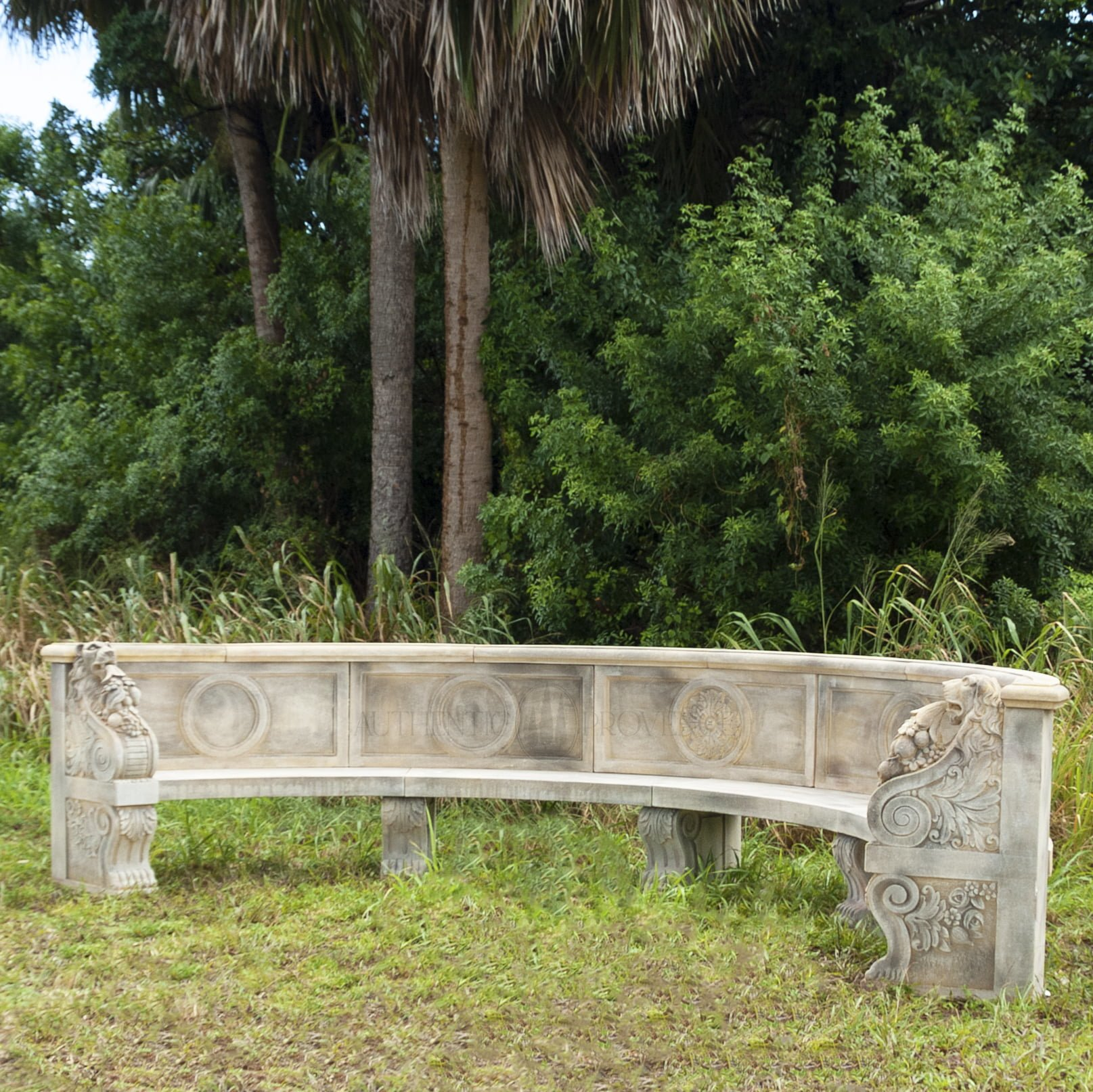 A very large half moon shape bench. Backrest consists of panels decorated with central circles