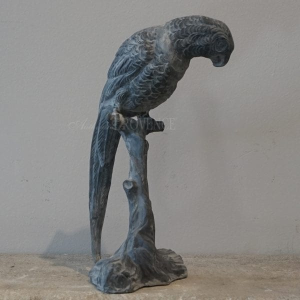 Lead garden ornament of a Parrot perched on a branch