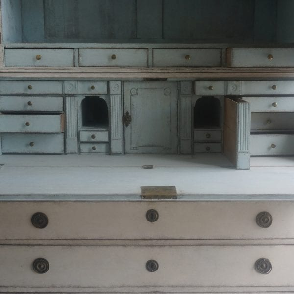 Close up view of a late 18th Century Swedish drop front secretary desk bureau with numerous drawers