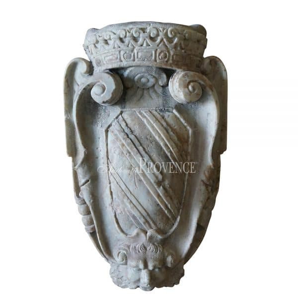 18th century monumental family crest wall mount. Hand carved marble with a lion, scrolls and topped with a crown.