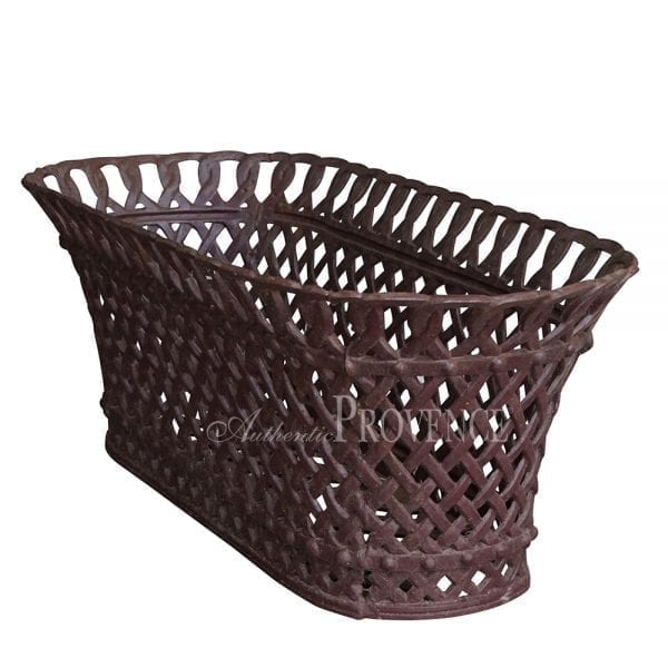 Side view of French oval cast iron woven basket planter with an intricate pattern.