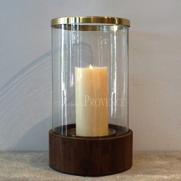 A minimalistwood base hurricane topped with a lightly antiqued brass ring. Candle is not included
