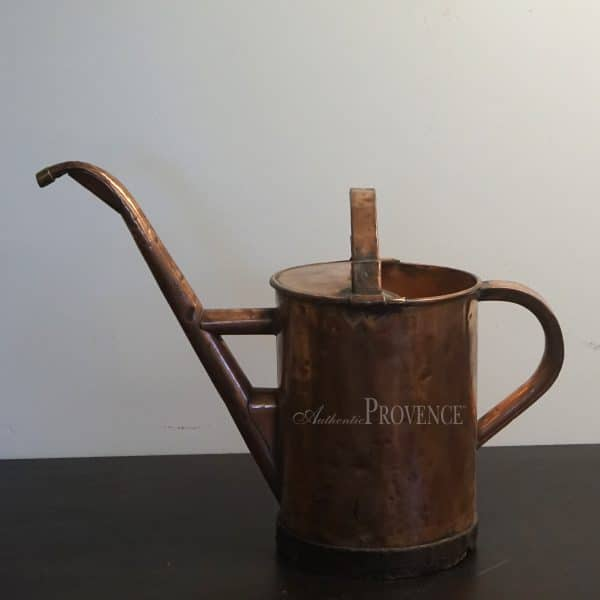 A beautiful French copper watering can