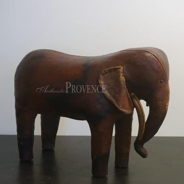 Leather elephant by Dimitri Omersa that boasts rich color and detailed construction
