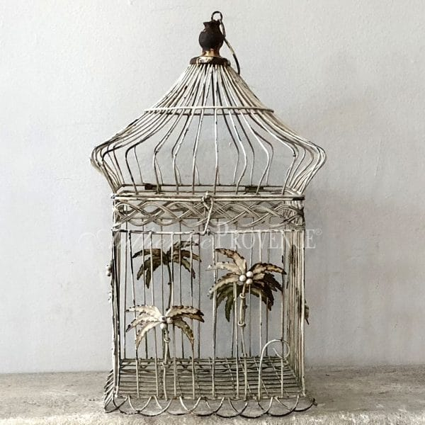 A vintage wire work bird cage with palm tree decor from the Victorian period in good condition.
