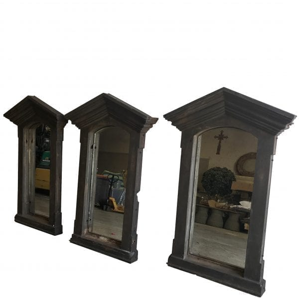 Close up of set of three industrial cast iron frames in the Neoclassical taste with antiqued glass mirrors.