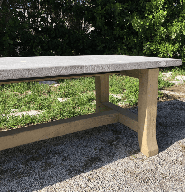 Close up of a Belgian Bluestone dining table with a rustic oak base