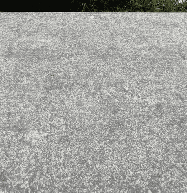 Close up of a long Belgian Bluestone dining table top