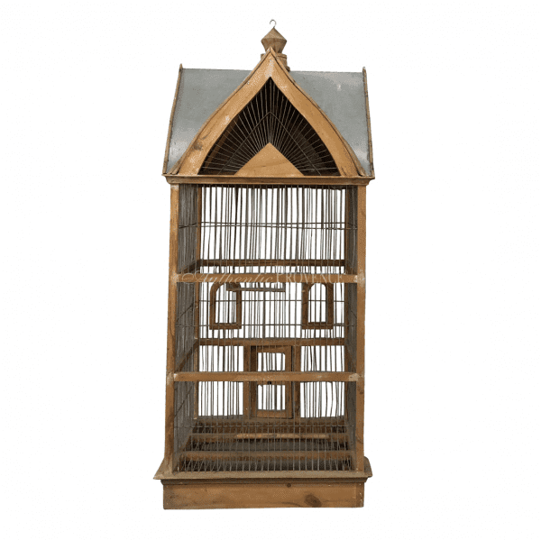 Back view of a French 19th century Normandy style vintage birdcage with a metal sheet roof. In good condition