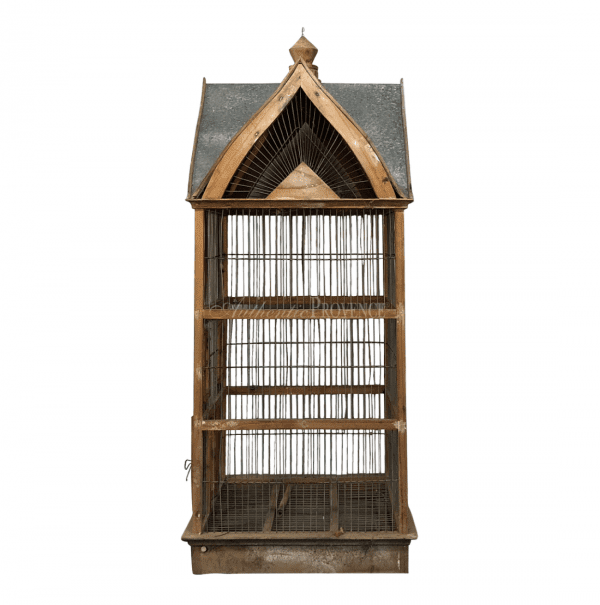 Side view of a French 19th century Normandy style vintage birdcage with a metal sheet roof. In good condition