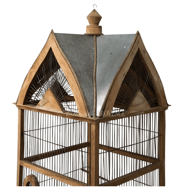 Top of a French 19th century Normandy style vintage birdcage with a metal sheet roof. In good condition