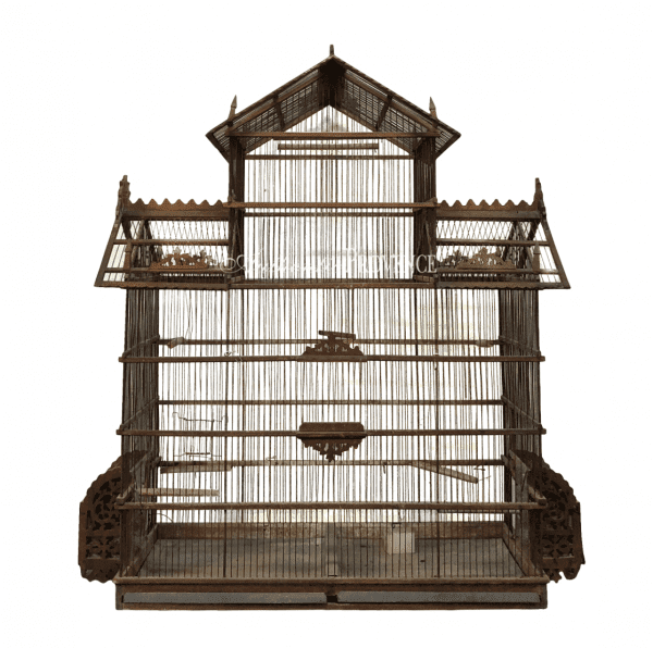 A French antique wire birdcage in pagoda shape made of walnut. The roof is decorated with filigree tracery carving in good condition
